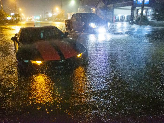 Motorists navigate a flooded Gause Boulevard in Slidell, La., late Friday, June 18, 2021, as a tropical disturbance neared the Louisiana shore