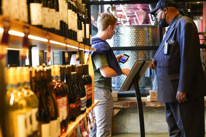 Security personnel ask customers for proof of vaccination as they enter City Winery Thursday, June 24, 2021, in New York.