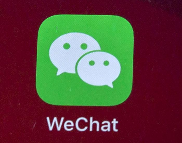 Icons for the smartphone app WeChat is seen on a smartphone screen in Beijing.