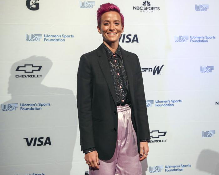 Soccer player Megan Rapinoe poses for photos on the red carpet of the Women's Sports Foundation's 40th annual Salute to Women in Sports in New York on Oct. 16, 2019.