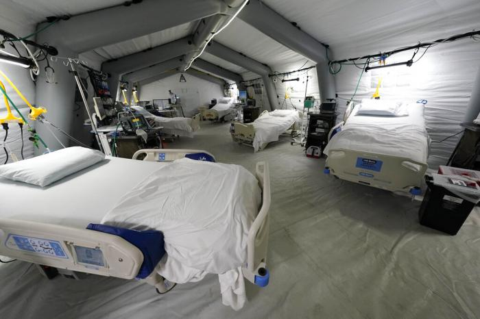 Five intensive care beds, part of the 32-bed Samaritan's Purse Emergency Field Hospital, are set up in one of the University of Mississippi Medical Center's parking garages.
