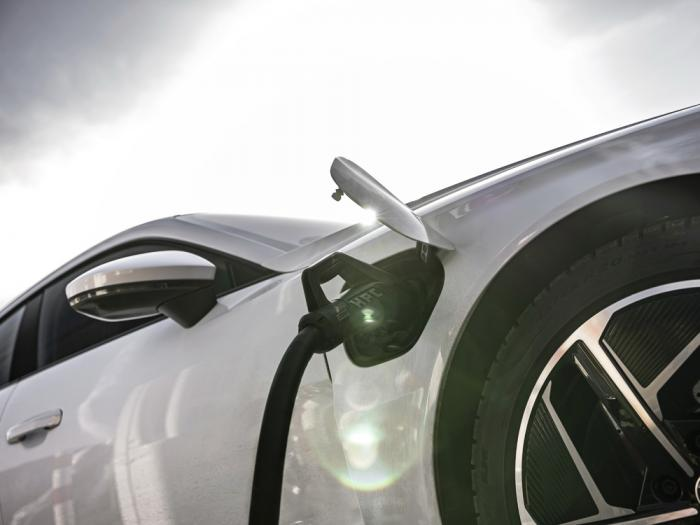 This photo provided by Audi shows the automaker's new all-electric production car, the 2022 e-tron GT, charging up at one of many public charging stations