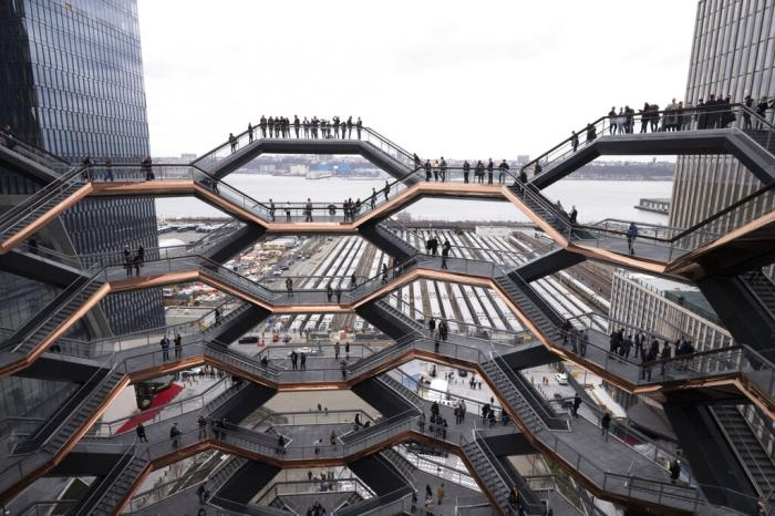 Visitors to the Vessel climb its staircases on its opening day at Hudson Yards in New York.