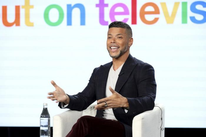 """Wilson Cruz speaks at the """"Visible: Out on Television"""" panel during the Apple+ TCA 2020 Winter Press Tour at the Langham Huntington, Sunday, Jan. 19, 2020, in Pasadena, Calif."""